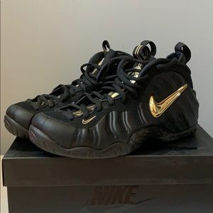 Nike black with gold trim Foamposite